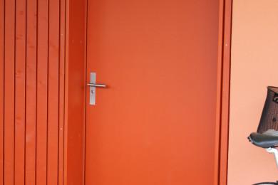 orange Holzwand - Holzbau - Holzhaus - Holzsystembau - PM Mangold